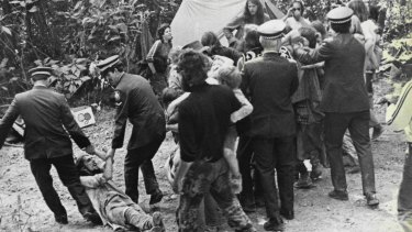Police drag away conservationists at Terania Creek in August, 1979.