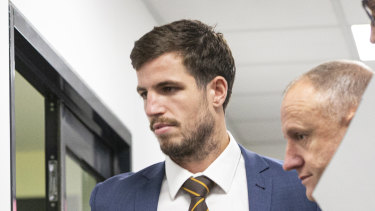 Ben Stratton leaves the tribunal after being banned for two matches and fined $1000.