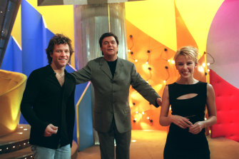 Kylie Minogue and Jon Bon Jovi with Daryl Somers on set of Hey Hey in 1997