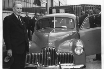 Ben Chifley, left, released the 1945 budget just days after the end of World War II. Four years later, he was on hand to see the first Australian-made car roll off the Holden assembly line in Melbourne.