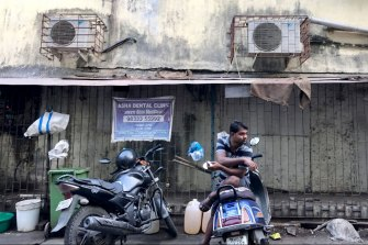 Air-conditioning units, like these shown outside a building in Mumbai, account for more than 40 per cent of the peak summer energy load in major Indian cities.