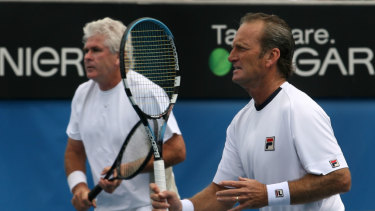 McNamara (right) alongside his old doubles partner Paul McNamee in a seniors match at the Australian Open back in 2008.