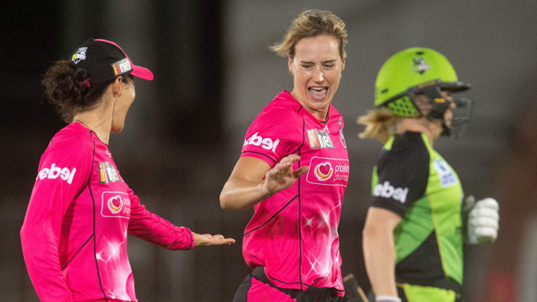 All-round excellence: Ellyse Perry reacts to taking the wicket of the Thunder's Alex Blackwell.