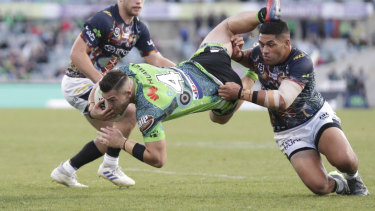 Crashing down: Nick Cotric heads for the turf in the loss to North Queensland at Canberra Stadium yesterday. The injury-riddled Raiders need to get back on track.