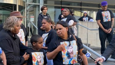 The family of JC assemble outside of Perth's District Court.