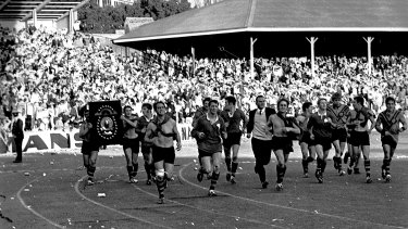 September reign: Balmain players parade the trophy on a lap of honour at the SCG after winning the 1969 grand final.