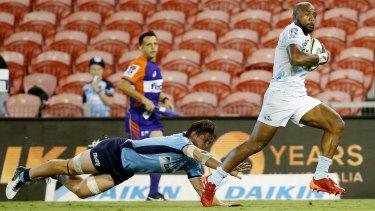Auckland's Mark Telea slips Michael Hooper's tackle to score on Saturday.