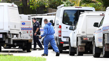 Scientific and forensic police officers scoured the Petrie street on Friday.