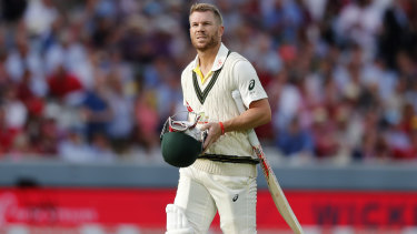 Gone: David Warner departs for three after being bowled by Stuart Broad.