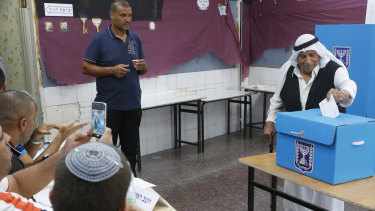 Israeli bedouin arabs cast their votes in a polling station in the city of Rahat, Israel, on Tuesday.