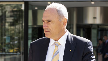 National Australia Bank Chairman Ken Henry leaves the Royal Commission into Misconduct in the Banking, Superannuation and Financial Services Industry at the Federal Court in Melbourne on Monday.
