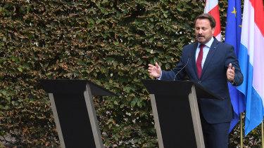 Xavier Bettel, Luxembourg's Prime Minister, beside the empty podium of British Prime Minister Boris Johnson.