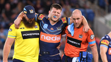 Early casualty: Jai Arrow leaves the field on Friday night after injuring his ankle during the Titans' loss to the Warriors.