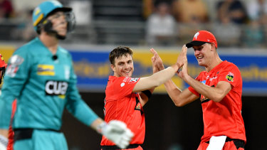On a roll: Renegades' Cameron Boyce (centre) celebrates after claiming the wicket of the Heat's Matthew Renshaw.