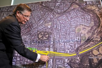Then premier Denis Napthine announcing land acquisitions for the doomed East West Link in 2013.