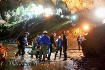 One of the boys is stretchered out of the Tham Luang cave, an expansive cave network that now also houses a museum.