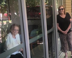 Mary Watson, right, visited her mother, Alice Bacon, at Newmarch House through the window for her birthday on April 5.