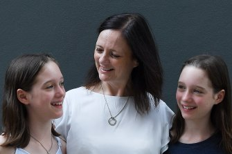 Kerry-Anne Baxter with her daughters Rosie, left, and Ellie, who fell with flu and will now be vaccinated every year.