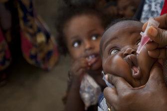 A baby receives a polio vaccine at the Medina Maternal Child Health Centre in Mogadishu, Somalia.
