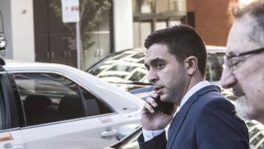 Mehmet Ozgen, left, outside court in May.