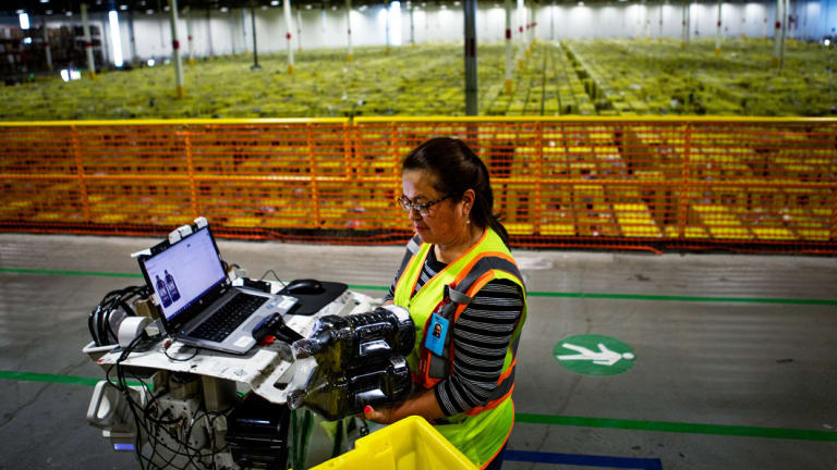 Julia Teran scans packages at the Amazon Fulfillment Center in Carteret, New Jersey.