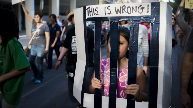 A child protests against the separation of families in Philadelphia.