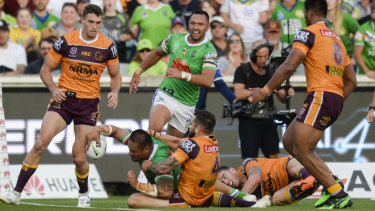 Back foot: Joey Leilua charges through the Broncos defence on Sunday.