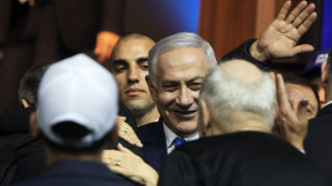 Benjamin Netanyahu, Israel's prime minister, centre, greets attendees at the Likud party headquarters in Tel Aviv, Israel.