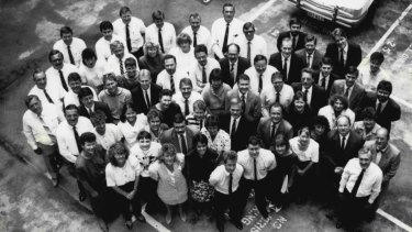 The first, and possibly last, group photograph of some of the inquiry's legal officers, legal assistants, investigative support staff, accountants, clerical and secretarial staff, investigative police, administrative officers and criminal analysts.