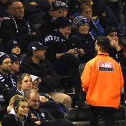 Security patrols the aisles at Marvel Stadium on Saturday night.