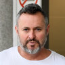 Fraud-accused Brisbane lawyer to remain in custody another night