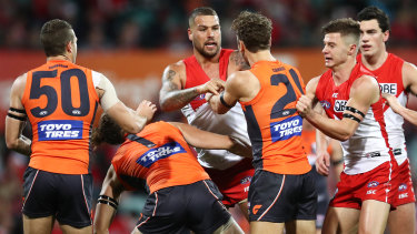 Well beaten: Lance Franklin scraps with Matthew Buntine during a forgettable match for the Swans marksman.