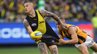 Thirst for ball: Dustin Martin (left) evades Hawthorn's James Worpel.