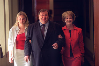 In happier days with wife Bevelly, from whom he is divorced, and daughter Amanda.