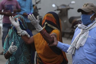 A relative of a patient who died of COVID-19 mourns outside a hospital in Ahmedabad in India on Tuesday.
