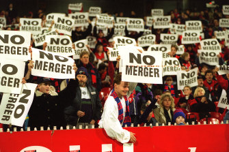 Melbourne fans show their opposition to the merger.