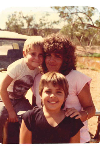Lee, at front, with brother Mathew and mother Margot in 1987.