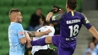 Friendly fire: Bart Schenkeveld of Melbourne City is kicked in the arm by his goalkeeper Eugene Galekovic.