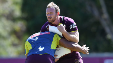 Prepared: Matt Lodge (right) training session ahead of the clash against the Roosters.