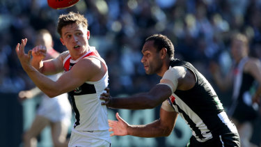 Travis Varcoe keeps tabs on Jack Billings.