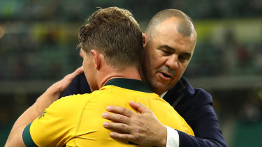 Wallabies coach Michael Cheika  and captain Michael Hooper embrace after Australia's loss to England.