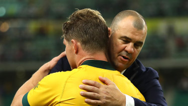 Emotional time: Michael Cheika and Michael Hooper embrace after Australia's loss to England.