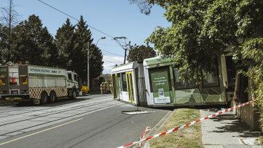 Cotham Road in Kew was closed after a tram derailed and smashed through a fence.