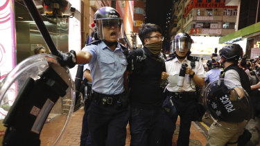 Police officers take away a protester in Hong Kong on Sunday.