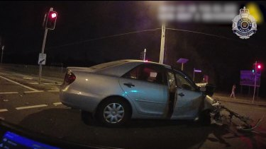 The innocent driver's car was a wreck after the impact in the middle of the intersection.