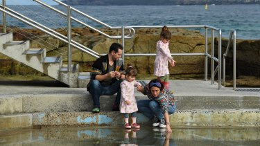 Tony and Gena Been with their daughters Winona, 5, and Daisy, 2, at the children's pool at Bondi Beach.