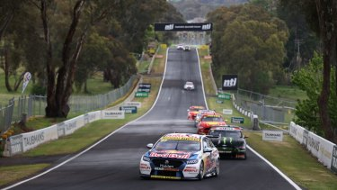 Straight and narrow: Holden driver leads the field down the famous Conrod Straight at Mount Panorama.