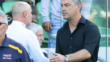 Fair play: Melbourne Victory coach Kevin Muscat shakes hands with Wellington Phoenix boss Mark Rudan after the 3-3 draw at AAMI Park.