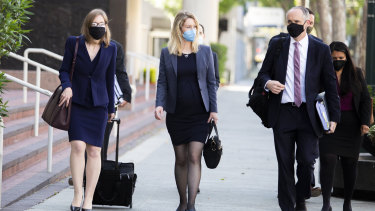 Theranos founder Elizabeth Holmes (centre) attends a court hearing last week.