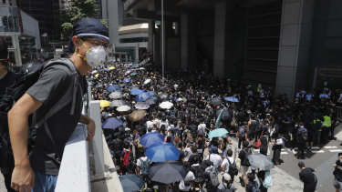 Protesters surround the police headquarters in Hong Kong on Friday.